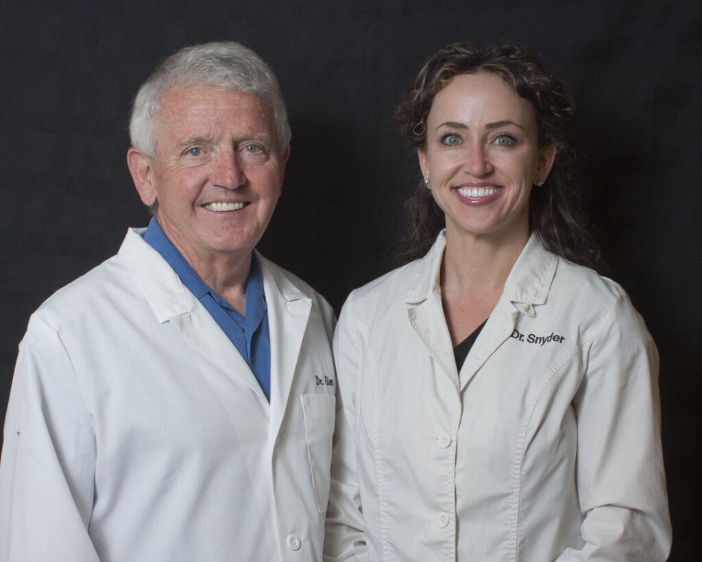 Headshots by Thornhill Photography/WhistlePixels - photo of smiling man and woman in dental lab coats