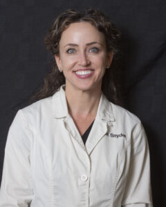 Asheville headshot photography by Thornhill Photography/WhistlePixels - photo of smiling woman in dental lab coat