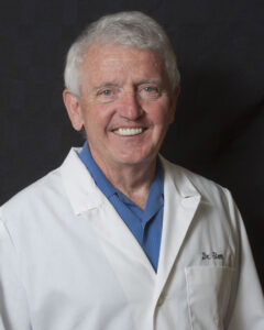 Asheville headshot photography by Thornhill Photography/WhistlePixels - photo of smiling man in dental lab coat